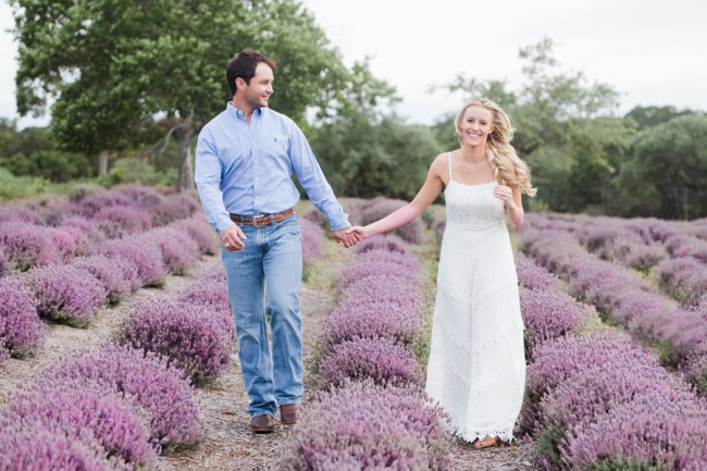 walking through lavender rows for engagement session