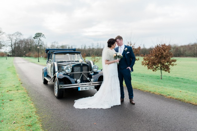 Newlyweds beside Darver Castle vintage car