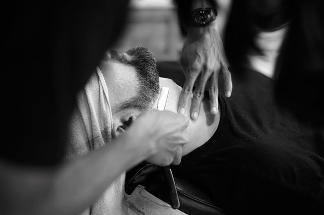 groom getting a straght razor shave