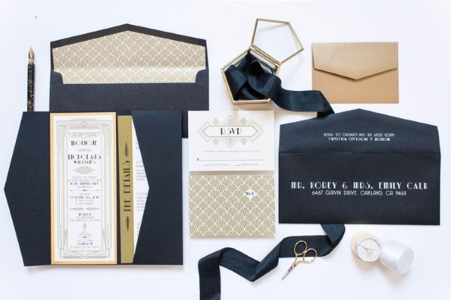 art deco gatsy themed gold black invite suite