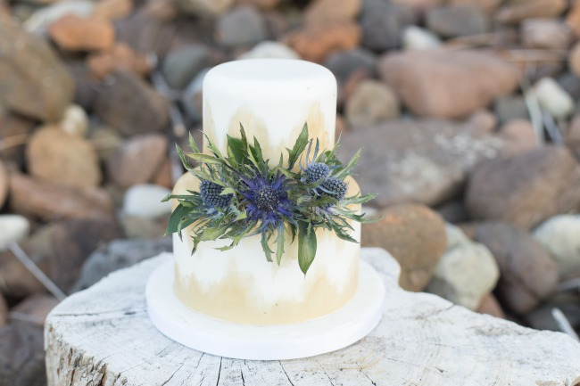 blue thistle decorated wedding cake