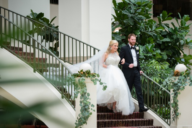 bridal couple decend staircase
