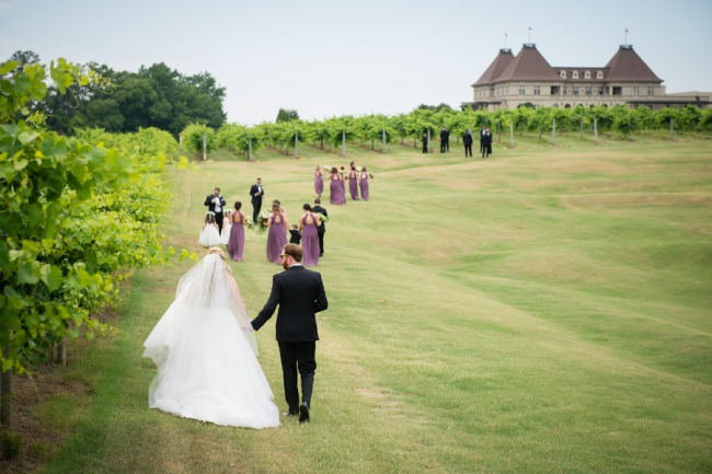 bridal party walk in Chateau Elan vineyards