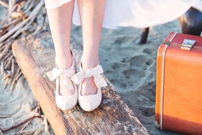 bride standing on beach wood