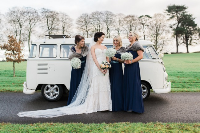 bridesmaids next to VW van