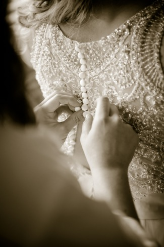 buttoning up back of bride's dress