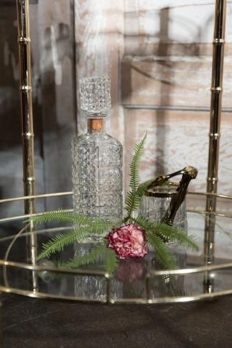 crystal decanter on vintage bar cart
