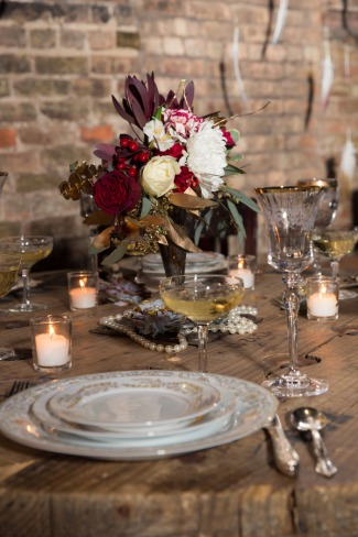 gold rim glasses and plates for table setting