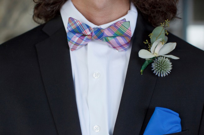 groom in plaid bow tie