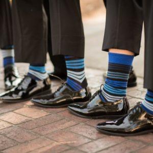 groomsmen showing striped socks