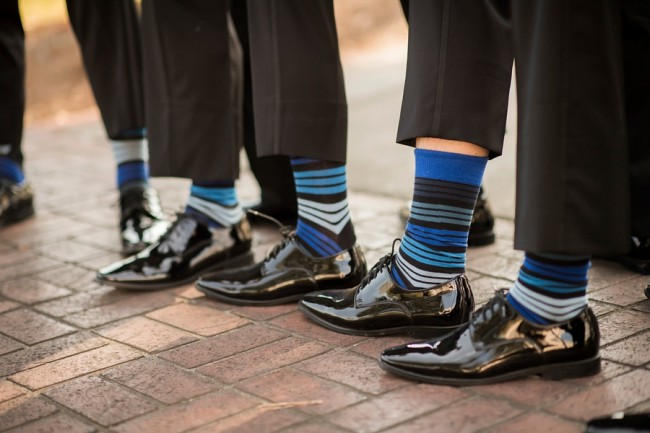 groomsmen showing striped blue socks