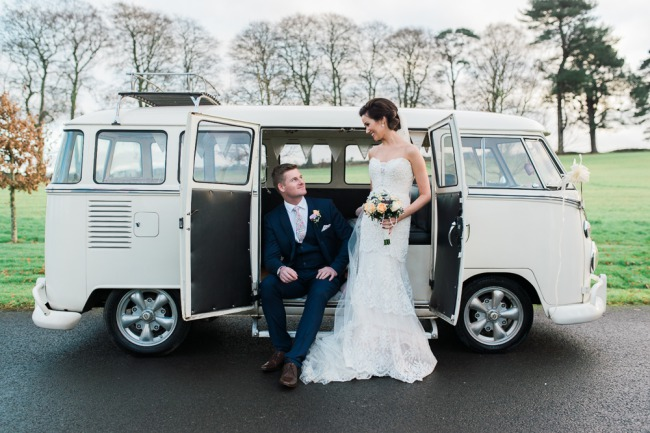 newlyweds at side doors of VW van
