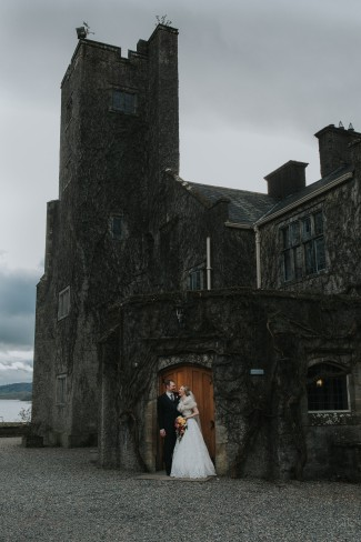 newlyweds out front of Belle Isle Castle