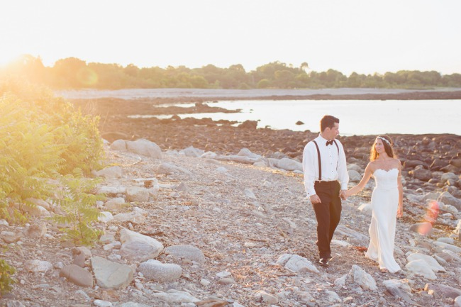 newlyweds walk along New Hampshire beach