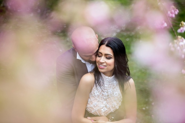 photo of couple through cherry blossoms defocussed