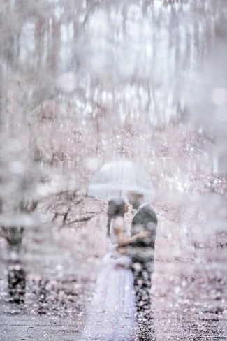 rainy sidewalk with couple's portrait