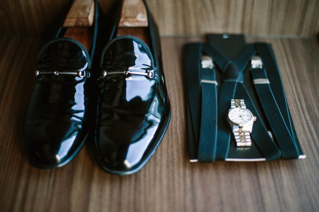 shiny black shoes and watch