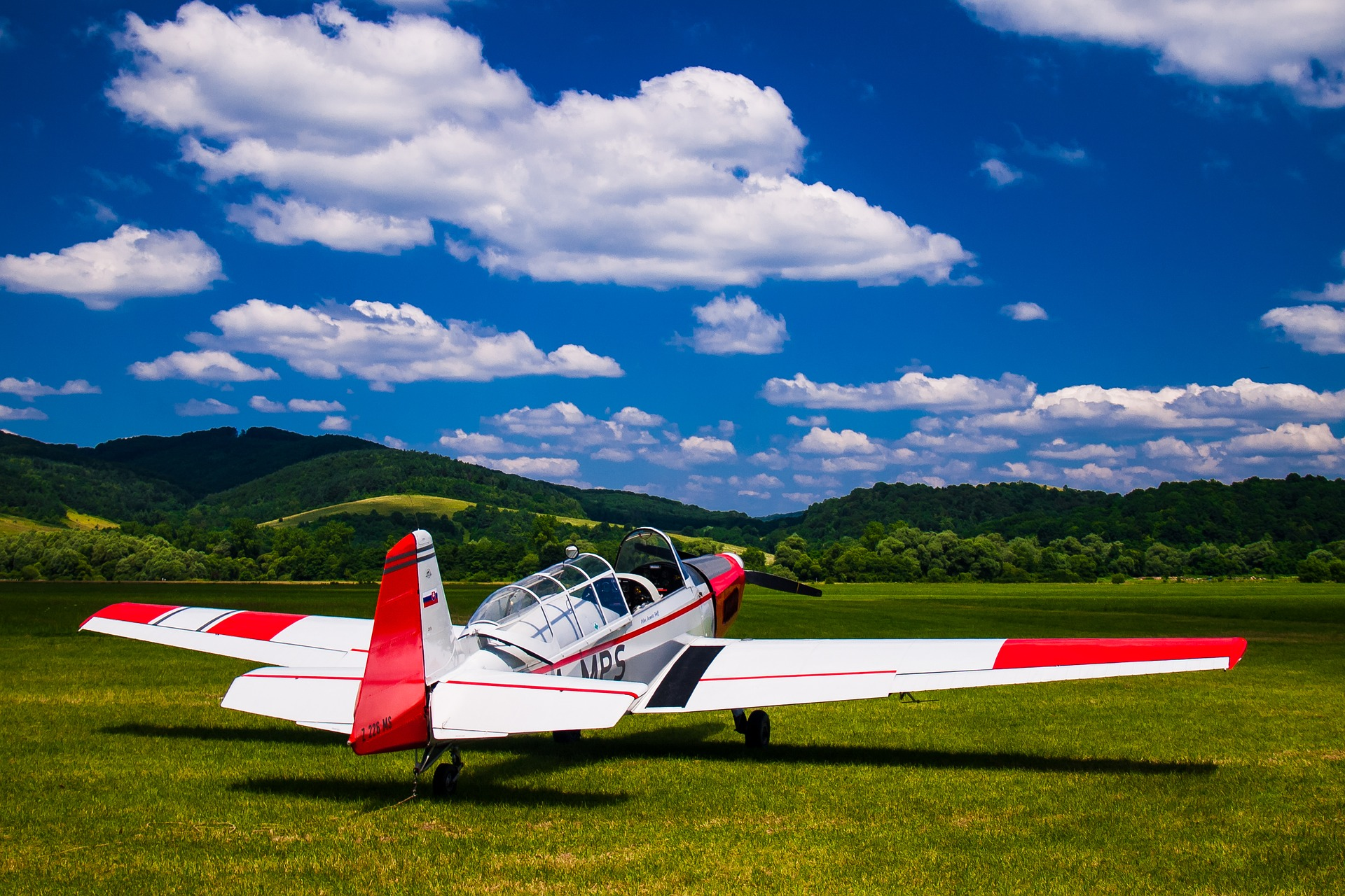 small airplane in field