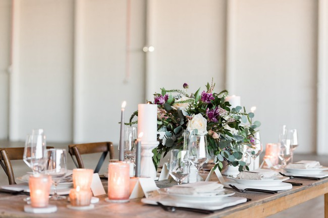 styled industrial greenery table with candles