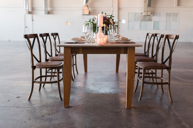 tablescape and chairs in middle of Hangar