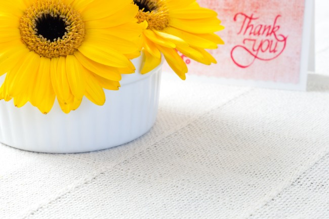 Yellow chrysanthemum flowers with thank you note