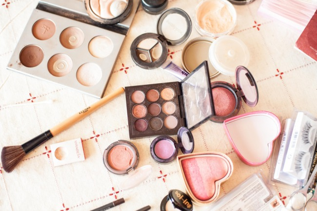 assortment of makeup supplies