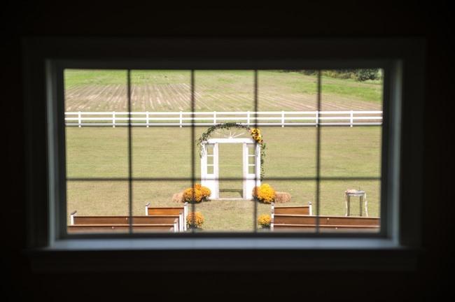 backyard ceremony setting framed through window