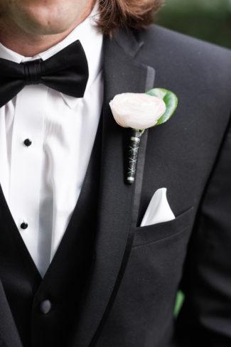 boutonniere on tuxedo groom