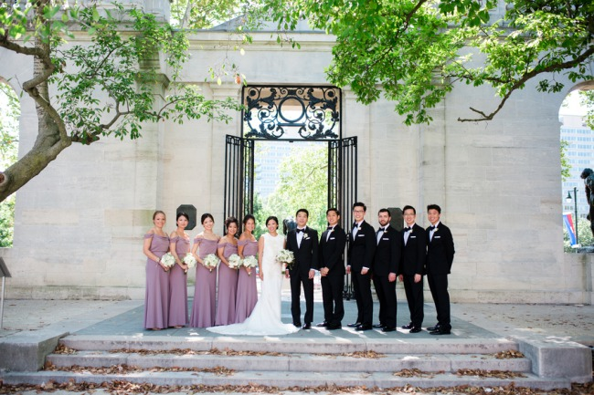 bridal party lined up in front of gates