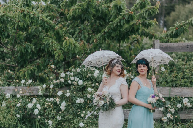 bride and MOH with parasols