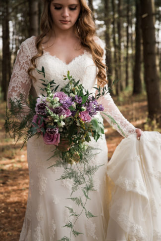 bride holding bustle and bouquet
