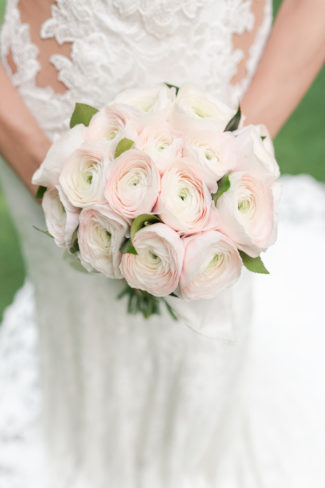 bride holds blush pink rose bouquet