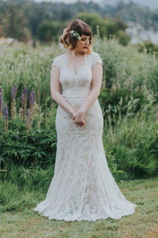 bride in sleaveless gown in garden