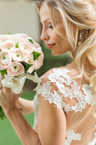 bride smelling bouquet