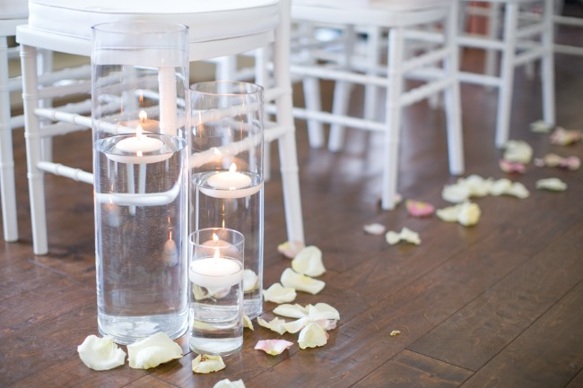 clear vases with floating candles