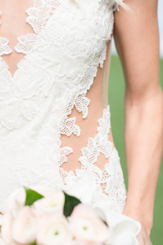 details of cut side of bride's dress