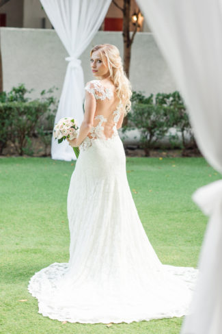 floral design details on open back bridal gown