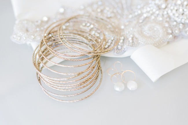 gold bangles and pearl earrings
