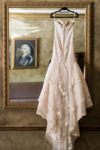 gown hangs from vintage mirror