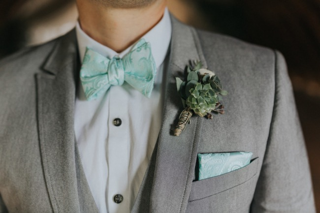 grey suit groom with succulent boutonniere
