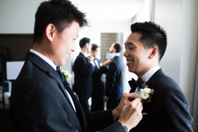 groom affixing boutonniere
