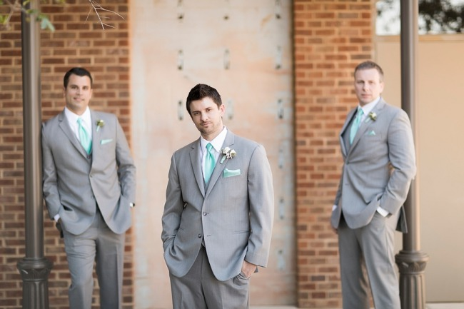 groom and two groomsmen standing outdoors