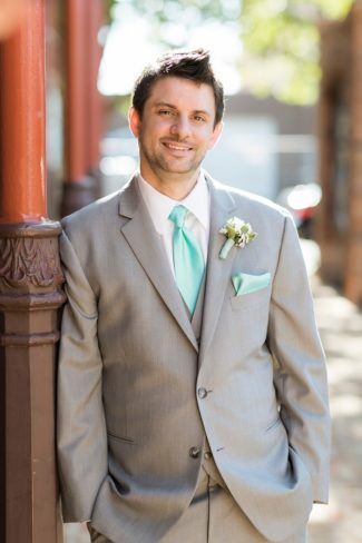 groom looking daper in tiffany blue necktie and pocket square
