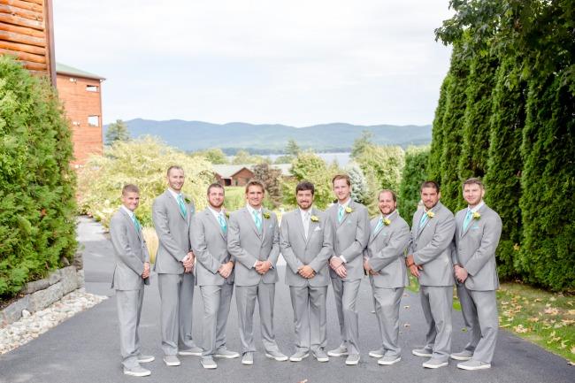 groomsmen in grey suits and sneakers