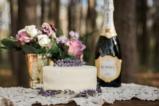 lavender topped cake with Korbel champagne bottle