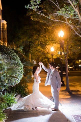 newlyweds dance under streetlights