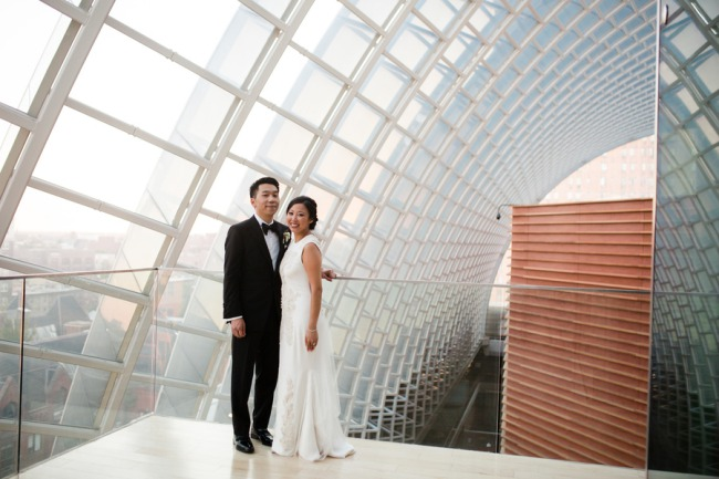 newlyweds stand in Kimmel Center