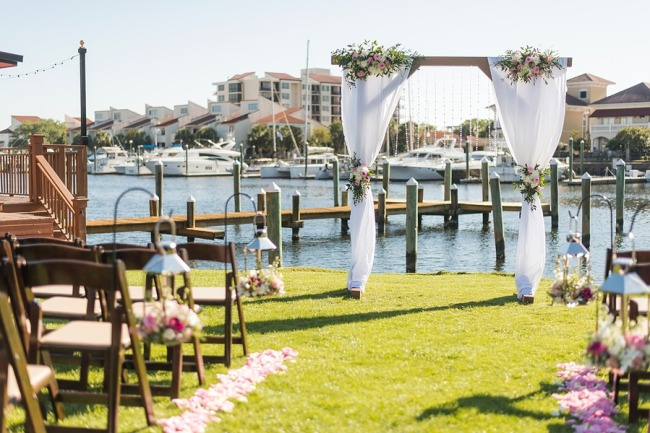 outdoor waterside ceremony with alter