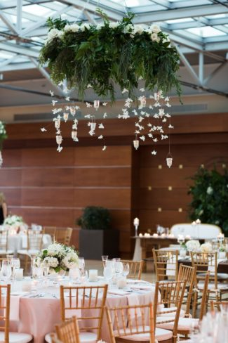 overhead greenery decor with hanging cranes
