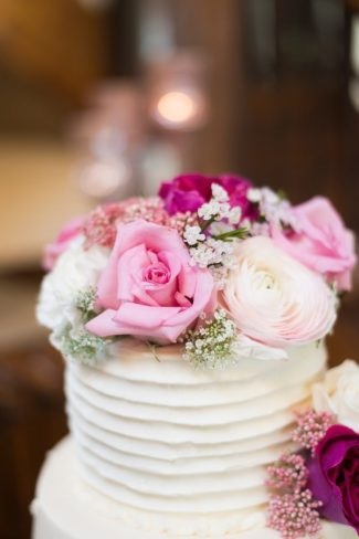 pink flowers and baby's breath on cake top
